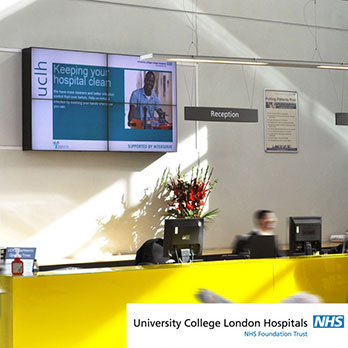 Digital signage four screen video wall displaying healthcare messaging in the University College Hospital atrium
