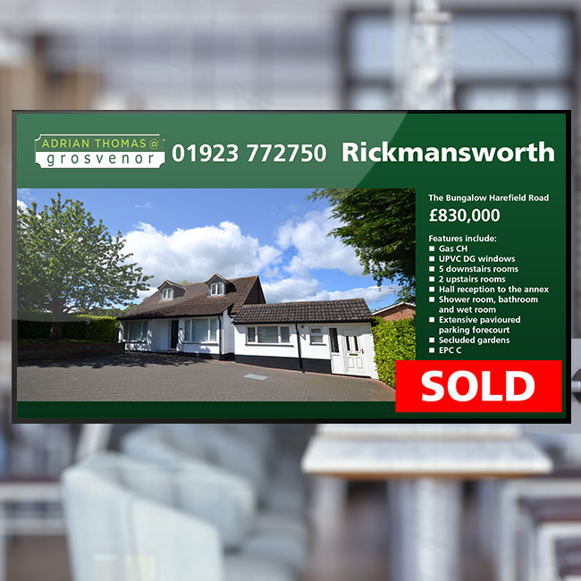 Digital signage retail window screen for Grosvenor Estate Agents displaying a sold bungalow in Rickmansworth