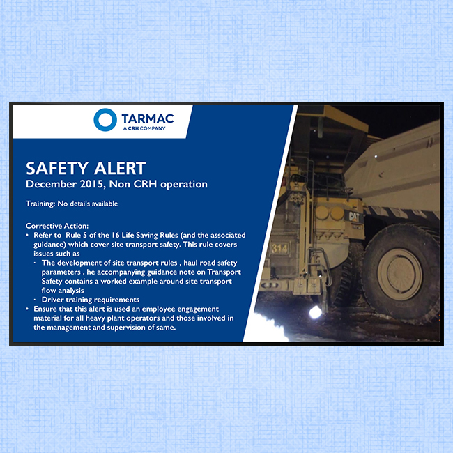 Digital signage screen for internal communications at Tarmac displaying a safety alert message