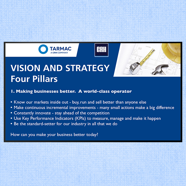 Digital signage screen for internal communications at Tarmac displaying a message about Vision and Strategy