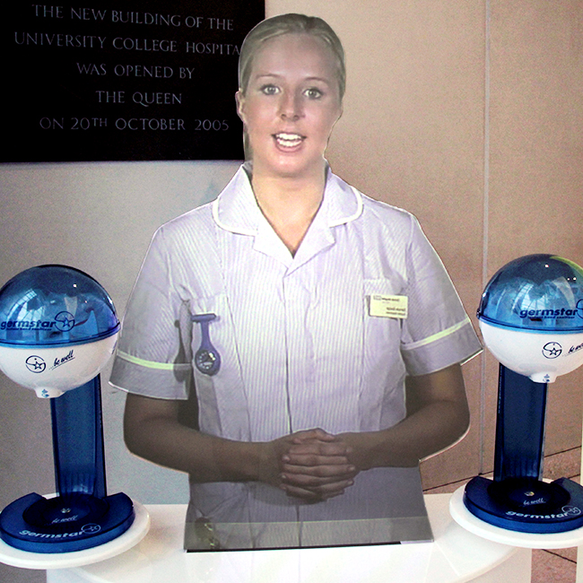 Close up of the holographic mannequin virtual nurse at University College Hospital in London with Germstar hand hygiene pumps