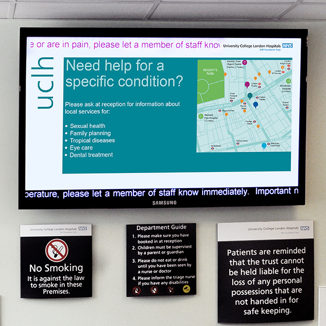 Healthcare digital signage screen at University College Hospital A&E showing where to go for help with specific conditions, such as sexual health, family planning, tropical diseases, eye care and dental treatment