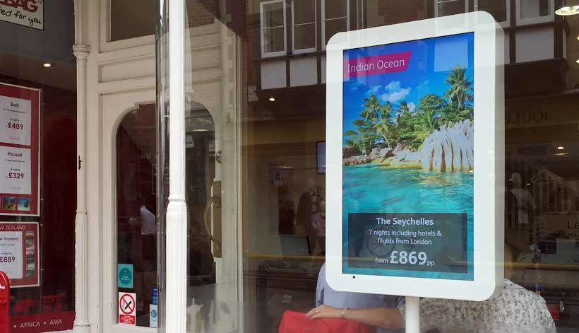 Travelbag digital signage screen window kiosk in retail store showing Indian Ocean Seychelles Promotion