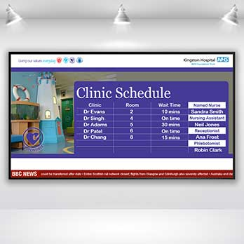 Digital signage screen displaying a hospital Clinic Schedule message on a white wall background with lights