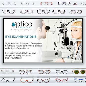 Retail screen in an opticians displaying an Eye Examinations message with spectacles on the walls around it